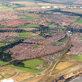 Dawdon from the SE at centre of frame, site of the former Dawdon Colliery left foreground. looking across the town to Seaton Village at top left and Grange Industrial Estate top right. Photograph c 2004Copyright FlyingFotos  www.seahamfromtheair.co.ukCopyright FlyingFotos  www.seahamfromtheair.co.uk