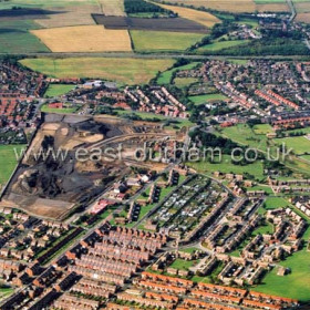 Low Colliery area at lower part of photograph. scar left by Seaham Colliery to centre. Eastlea and Westlea top left, Melrose/Milldale top centre then Park View, Byron Tce., Seaton estates and Seaton Village top right. Photo c 2003.Copyright FlyingFotos www.seahamfromtheair.co.ukPhotograph September 2003.