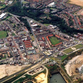 Town centre from the east, East Shore Village on the site of Vane Tempest Colliery beginning to take shape at top right in August 2003.Copyright FlyingFotos  www.seahamfromtheair.co.uk