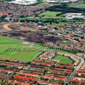 Deneside streets, The Avenue, Bethune, Colling and Malvern at bottom of frame. Low Colliery centre right, Mill Inn, Seaton Estates and Grange Industrial Estate at top in July 2003.Copyright FlyingFotos  www.seahamfromtheair.co.uk