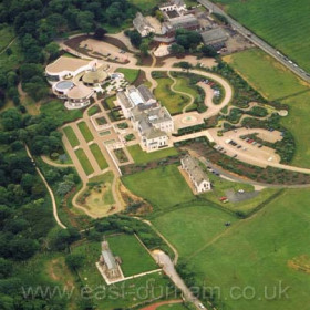 Seaham Hall Hotel in 2003. the 7th century St Mary's Church and vicarage in foreground.Copyright FlyingFotos  www.seahamfromtheair.co.uk