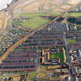 Looking south across Dawdon to the site of the former Dawdon Colliery. The square of light coloured roofs just below centre was the site of Swinebank Cottages.Photograph c 2004.Copyright FlyingFotos  www.seahamfromtheair.co.uk