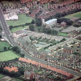 Mill Inn centre left, Cosy Cinema top left, Melrose Cres and St Cuthbert's Church centre top.  1980.Aged Miners Homes and Park View at bottom of frame.