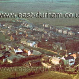 Seaton Village from the south east. Rear of Dunn Cow Inn at lower right.  1980