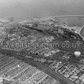 Central area, dock and eastern side of Dawdon from the SW c 1960.Gasworks and empty Bottleworks Field right centre. Dawdon streets, Illchester, Fox, Strangways and Cottages Road at left foreground. Good view of the South Dock staithes.