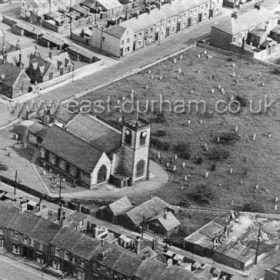 St Johns Church in the 1950's, Caroline St and Sophia St at the top alongside the National School at the western end of Church Street. Marlbro St in foreground, public toilets (with timbered front behind).