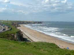 Seaham beach, looking towards Sunderland, 4 or 5 miles to the north. Seaham Hall and the ancient St Mary's church are about 150 yards west of the road. Photograph taken in 2004.