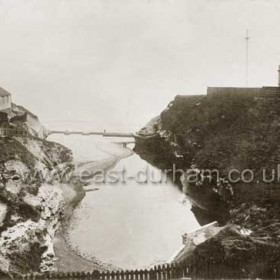 The mouth of the Dene known as Bessies Hole. Derelict Baths, Scout's Hut at left, Coastguard Station at right in 1910.