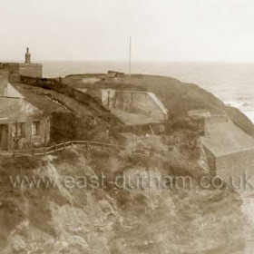 Bath house with battery behind, Featherbed Rock to right, cannon clearly visible on cliff top. c 1900 possibly earlierBaths demolished in 1936 the North Battery behind demolished in the early 50's afer housing squatters for many years.