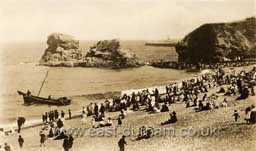 Featherbed Rock with Volunteer targets and beach railway c 1905.  Most but not all of the firing practice was from the Terrace Beach to targets on the south side of the Featherbed Rock.