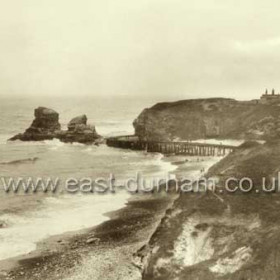 Beach and railway in the early 1900s.