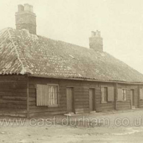 """Old wooden houses first called Wood Cottages then Marquess Cottages or Wood Houses. These buildings were the first houses erected in Seaham Harbour ( before 1828 ) on what is now the Terrace Green, later moved to a site at the northern end of  Pilot Tce ( at the NE corner of the Bottleworks area )  they were demolished in 1934.The first child born in the new town of Seaham Harbour, John Seaham Prudhoe was born in these houses in 1828. See the """"Families"""" section."""
