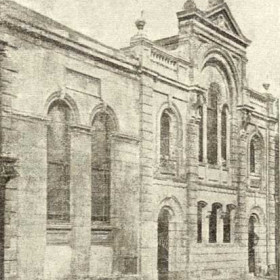 United Methodists originally worshipped in a Tabernacle in upstairs rooms of a house or houses (built early 1840s) which originall occupied this site. This the first chapel, built in 1846 was enlarged in 1866 and again in 1877 to seat 750, it was burnt out in 1904 and was replaced in 1905 by the chapel in the next photograph.