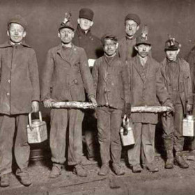 Everyone has their mess tin, the men with sticks are coal-trolley breakers. Some wear gloves, a surprising safety measure for the time, 1911.