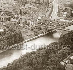 Framwellgate Bridge seen from the Cathedral.This photo was taken before 1965, when new roads and bridges were constructed to take through traffic away from the market place. Caption from Malcolm Fraser  .