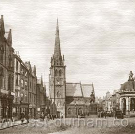 Durham Market Place, dominated by the Church of St Nicholas. c 1910      The domed structure on the right, with the statue of Neptune on top was 'The Pant', originally the only water supply in the City, which was fed from the Fram Spring up near the railway station. The pant was the responsibilty of a 'Pant Master' who received one shilling (5p) a year. This amount was still being paid to the City Engineer in the 1960's.  Caption from Malcolm Fraser