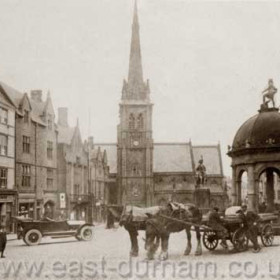 Market Place, Durham City, the Church of St Nicholas in the background. The pant in the right foreground was demolished in 1923.
