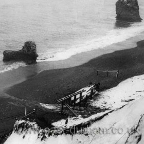 """The upturned """"George Elmy"""" on Chemical Beach, just below centre of frame."""