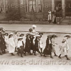 Children from the National School in Church Street walking up Marlborough Street on their way to Sunday School treat in the dene. (Dalton le Dale ) 1910