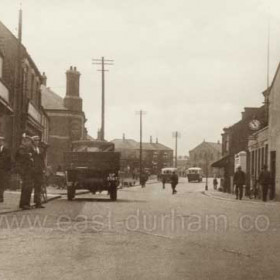 Front Street Hetton in the 1930s. This is looking north-north-westward at a point near the church or chapel, which is out of sight to the right.  There is or was a Wesleyan Chapel behind the photographer. Partially hidden by the more distant of the two single-deck buses is what later became Hetton Library but at the time of the photograph it would have been a school.   Caption by Sheldon Clark