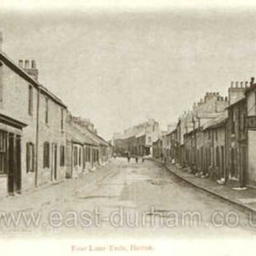 """The New Inn at Four Lane Ends, Hetton 1907. This is looking south-eastward from the crossroads at Four Lane Ends, towards Pemberton's Bank and Easington Lane.  Just out of sight beyond the houses in the distance was """"The White Gates"""", where the Lambton, Hetton & Joicey Railway crossed the the Lambton, Hetton & Joicey Railway crossed the Easington to Wardley road (later A182), on its way from Hetton Colliery to Elemore Colliery.  """"The White Gates"""" remained the official name for the local bus stop for many years after the railway closed in 1959.   Caption by Sheldon Clark"""