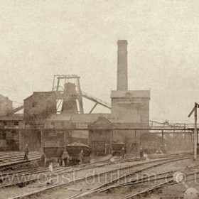 """South Hetton Colliery. This shot again shows the surface facilities, including the screens and a number of the chaldron wagons (see HET 009) which were to be found in one form or another all over the Northumberland and Durham Coalfield from the days of the wagonways in the 18th Century until at least the late 1960s, when I saw some just a few yards from where the photographer was standing when he made this exposure.  The signal appears to be of the wooden """"slotted post"""" type so much favoured by railways in the North East of England, some having been preserved on the North Yorkshire Moors Railway at Grosmont and/or Goathland, I believe.   Caption by Sheldon Clark"""