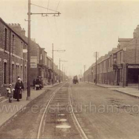 Four Lane Ends, Hetton in the 1920s. This seems to show the Easington to Wardley road (later A182), looking north-westward in the direction of Hetton from the bottom of Pemberton's Bank, a fearsome hill which remained cobbled until at least the 1960s.  The tram track laid into the road led from Easington Lane clock and War Memorial to Sunderland via (I think) Philadelpha and Herrington Burn.  The business premises on the right was a hairdresser's in the 1960s. Caption by Sheldon Clark
