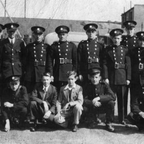South Hetton contingent of the National Fire Service in 1942, behind the garage on Front Street where their appliance was kept.  My father, John Sheldon Wesley Clark, is crouching at the right end of the front row; I suspect that the left hand one of the two in 'civvies' is George Stewart, who was a bricklayer down the pit.  Like my father, George became a Church Warden and then Church Warden Emeritus at South Hetton Holy Trinity Church.                         .Photograph and caption from Sheldon Clark.
