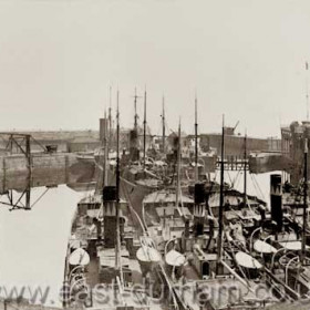 Seven ships of the Londonderry Line, instantly recognisable by the ' dangling carrot ' funnel markings, in the North Dock. The Viscount Castlereagh at left.Probably around or just before 1900