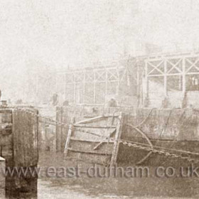 Removal of dock gate prior to replacement during a major refurbishment and enlargement of the dock in 1888.