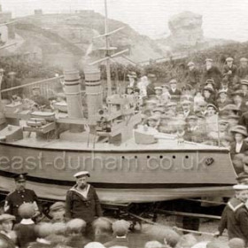 ' HMS King George ' built by coastguards and Royal Naval Reserve. Old baths and battery behind. Celebrations to mark the coronation of King George V and Queen Mary in 1911
