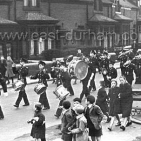 "Dawdon Church Lads' Brigade marching in Princess Rd around 1950. Joanna adds ""The guy in front carrying the mace is called Gibson . The central drummer is Ronnie Nelson, big drum ' Mac' can't remember his name. The third bugler back is my dad, Jim Tulip. The ocassion was church parade from St. Hild and St. Helen church  back to the drill hall up from the Castlereagh Hotel beside the Co-op. Photo probably late 1949"""