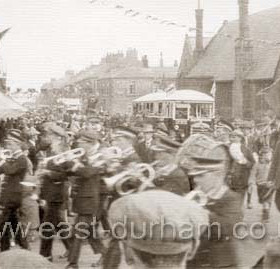 The Dawdon Pageant of 1934, parade here turning right from Church St into Blandford Place. National School in background.