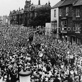 Banners entering Durham City at Durham Miners Gala (Durham Big Meeting) in the 1950s.