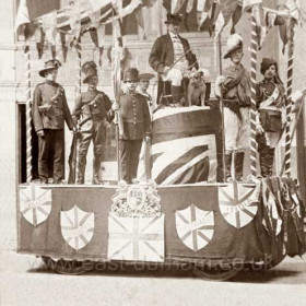 """Slightly different shot of """"John Bull and his Empire""""  built by the sergeants Mess of R.F.A. pictured in front of the Drill Hall. Coronation celebrations 1911"""