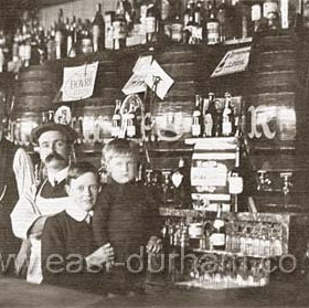 J W Botcherby ( with watch chain ), his children and a barman in the bar of the Seaton Colliery Inn shortly after 1900. One of the boys was killed serving in WW1. The pub was destroyed in a German air raid during Oct 1941.