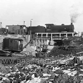 Cutting the underpass through to York House and Tempest Rd.   The area to the left of the crane now level and grassed was originally part of the Dene and this deep hole became the town rubbish dump in the late 1940s, early 50s.