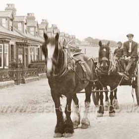 Seaton Lane shortly after gas lights were erected ( 1913 ) and Clark's Terrace built ( 1911 ). The young lad on the farm cart is Billy Dow.  Blacken Pot Square at the NE corner of the village green is just visible in the distance at centre. Blacken Pot Square, probably built for farm hands as early as 1600 was low quality housing with outside staircases, I believe some mining families lived there in the late 1800s early 1900s. Reputed to have been a slum in it's later days it was demolished in the 1930s? In the 1950s Billy Dow built a bungalow on the site of the former square.