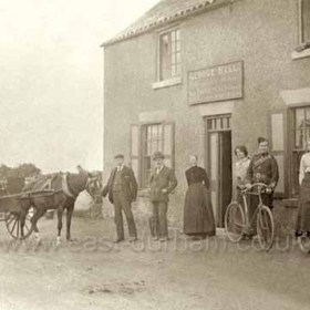 The Dunn Cow, Seaton Village, a public house since 1851, possibly earlier. The two Scottish girls were on holiday in the village  and had a holiday romance with the two Volunteers. Photograph probably between 1902 and 1910.
