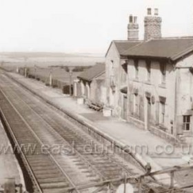 Seaton Station (looking east), stationmaster's house and east-bound waiting room at right, crossing gates on Seaham to Houghton le Spring road (B 1404) in foreground. Station closed 1951. Photograph 1930s?