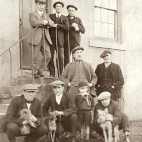 Regulars at the side door of the Dunn Cow Inn, Seaton Village, in1921. Some are villagers, some are Murton men. Back row from left- J Elliot, Tommy Steel, Tadger Bell.  Middle Row from left - John Rawling,  Peter Appleby,  Front Row from Left -   J Jackson (Murton), Wm Rawling, J Rawling (boy), Gibson (Murton) Thanks to E Rawling for correcting names.