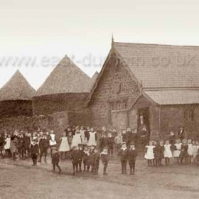 Seaton Village School in 1912. The school was built in 1861, enlarged in 1896 and closed in 1938 it now serves the village as a community centre. Prior to 1865 children were educated in a barn on Thomas Bolands farm at the east end of the village. Prior to WW2 a monthly farmers barn dance was held here when farmers and their wives supplied food and drink and waited on their workers. Broughs stackyard to left.