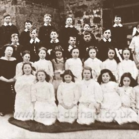 """Pupils at Seaton Village School in 1912/13. Jim Curry says """"Pupils are named as including Vera Best, Sarah Taylor, Carrie Furness, May Carr, Millie Thompson, Anne Spoors, May Swan, Nora Wiseman, Ethel Vuerry, Hannah Taylor, Jennie Curry, Mary Hannah Reay, Ethel Dawson, Dorothy Thompson, David Bissett, George Lumssden, Robbie Spoors, Norman Furness, Joe Dixon, W Bissett, Fred Dixon, Willie Reay, Henry Reay, John Peel and Harry Tarbitt. Head mistress was Mrs. Reay and a teacher Miss Murray. Barbara Carr (Middlemiss)who sent in the pic is 3rd from left front row."""""""