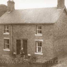 """John William Royston in front of the 2 railway cottages at Seaton Bank Head, just west of """"Darkies Plantation"""". This building still had no mains electricity in the 1960s. According to my grandmother, Darkie was a Scotsman who, in the late 1800s, would wander through the wood at night playing his bagpipes. Buildings now demolished, probably c1980."""