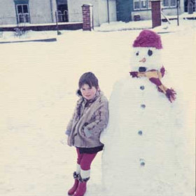 """Lynn Angus, now Thompson in 1970 (Lynn is the one without the hat), this photograph is not here to demonstrate my snowman building prowess but to show the Seaton Lane Inn, unaltered since 1949, in background. The outbuilding with entrance to the pub was the """"cellar""""(warm beer in summer, icy in winter), the doorway at right (behind the telegraph pole) was the entrance to the gents toilet, the ladies toilet, also outside, was at the rear of the building. The Ryhope Grammar scarf should bring back memories for quite a few people."""