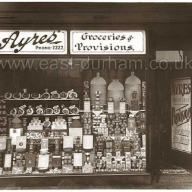 Ayres' Grocery shop in the New Arcade at the junction of Church St and Blandford Place  in 1934.