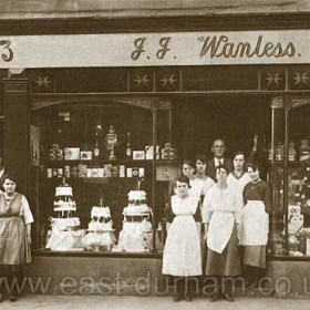 John Joseph Wanless with staff and possibly family at 23 Church St. in the 1920's. In 1921 the shop was listed as Dining Rooms and Confectioner and in 1925 as Confectioner. On south side of Ch St