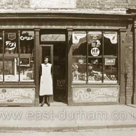 Mrs Franklin as a young girl outside J W Wheatons general dealer's shop at 10 Blandford Place in 1925. Mrs Franklin lived in Cornelia Terrace and had two sons, John and David.