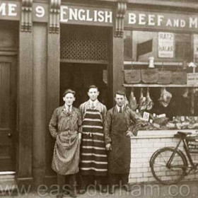 Built in the early 1850s this shop at 9 Church St  was still a private dwelling in1865, by 1873 it was a butcher shop owned by Thomas Gibson. Shown here in 1929 with owner Amos Paxton ( centre ) it was bought by the Chaytor Bros George, Harry and Neville ( Tommy ) in the early thirties.George had previously owned a butcher shop at 11 Sophia St.  The Chaytors continued to trade ( for the last 20 years or so through Harry's son Graham ) until 2000. The shop is now run by Gordon Griffiths (( GRIFF), even to his mother apparently )) as MeatMart. Amos Paxton died I would guess in the 1960s.