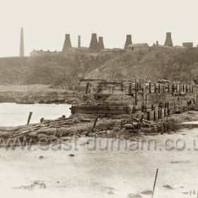 Derelict central pier in old south dock photographed on 16/6/1900.Candlish Bottleworks on cliff-top.